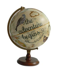 Track your flight patterns with this ivory push pin globe with birds and customized dark grey text