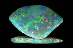 The Dark Jubilee Opal is a 318.4-carat free-form polished black opal from a mine in Cooper Pedy, Australia. Smithsonian Museum of Natural History