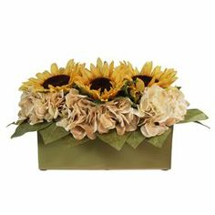 """Silk sunflower arrangement in a ceramic window sill planter.   Product: Faux floral arrangementConstruction Material: Silk and ceramicColor: Yellow, brown, creme and greenFeatures: Includes ceramic window sill planterDimensions: 8"""" H x 14"""" W x 8"""" D Note: Suitable for indoor use only"""