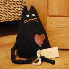Black Cat Doorstop - they're sold out but I bet I could re-create this myself
