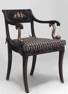 English Regency brown lacquered Chinoiserie design arm chairs with gold cushion and dolphin arms