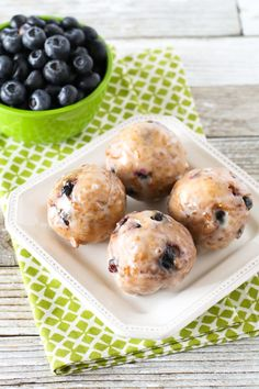 Gluten Free Vegan Blueberry Donut Holes. Crispy on the outside, fluffy on the inside. These donut holes are BURSTING with fresh blueberries!