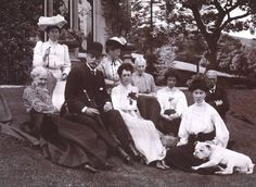 Group of people sitting in garden, 1905. Titled: 'Aikenshaw July 1905. Miss Louise Stuart, Miss Grant, Mr Parker, Miss Parker, Francess, Mrs Jameson, Miss Davidson, Jessie, Mr W S Turnbull, Stroncher'.