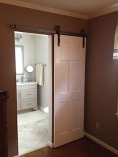 sliding barn doors are beautiful in this Raleigh bathroom design