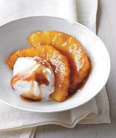 Caramelized Pineapple With Coconut Sorbet | Relive that Hawaiian vacation with caramelized pineapple at home. In just 15 minutes, you can sit down to a simple, tropical treat. Start with fresh pineapple, cored and cut into half-moons or halved canned pineapple rings. Melt a pat of butter and some brown sugar in a skillet, then add the pineapple and cook, about five minutes per side, until the pineapple is tender and caramelized. Top each serving with a scoop of store-bought coconut sorbet…