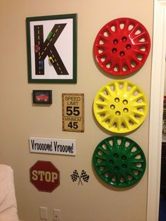 Race car room - using hubcaps to mimic a stop light. So cool. Race car room - using hubcaps to mimic Boy Car Room, Race Car Room, Boys Car Bedroom, Truck Room, Big Boy Bedrooms, Man Room, Car Bedroom Ideas For Boys, Racing Bedroom, Race Car Nursery