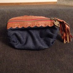 American rag denim makeup bag Blue with brown trim and cute tassel on zipper American Rag Bags Mini Bags