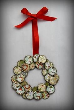wreath made from bottle caps. could also use tin can lids and recycled christmas cards