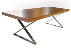 Our X Base dining table provides an unexpected sparkle with its stainless steel base.