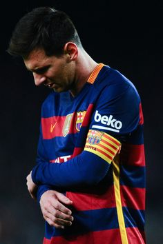 Lionel Messi of FC Barcelona reacts after clashing with Adan the La Liga match between FC Barcelona and Real Betis Balompie at Camp Nou on December 30, 2015 in Barcelona, Catalonia.