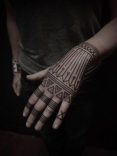 Cool geometric tattoos.. not on the hand though.  The ankle and way smaller