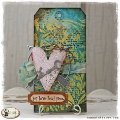 Tuesday Tutorial: Let Love Lead You by Tammy Tutterow.  Heart and Key die by Tim Holtz.  Compass and label by Sizzix/Echo Park Thinlits.