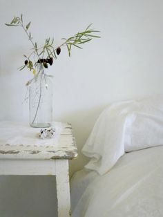 Minimal bedside table with flowers.