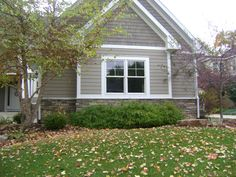 Taupe exterior, white trim. I wonder if I could put shingling anywhere on our house....