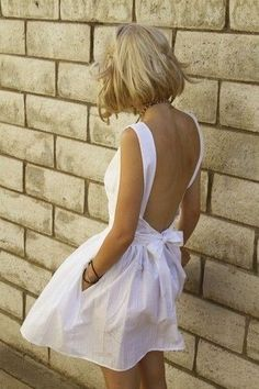 Low back white bow dress