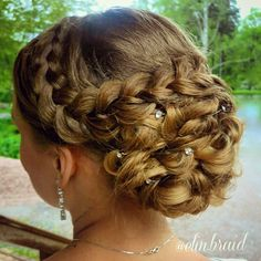 Side Braids decorated over a bun of twists with pearls.
