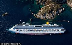 An incredible aerial shot looking down at the doomed Costa Concordia shows just how far it has listed onto its side