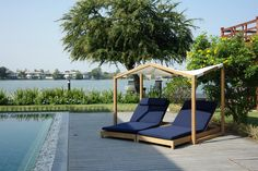 deesawat folds canopy over butterfly lounge bed for two