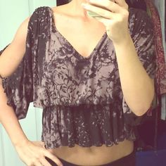 Free people butterfly open sleeve crop top With a sexy low back, this top is sure to turn heads! Never worn Free People Tops Blouses