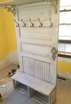 A husband nails an old door into the wall. A few steps later? What an awesome kitchen organizing idea!