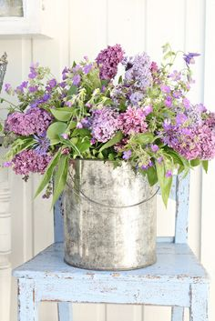 pales | blues | lavender | green | chair | metal bucket | flowers
