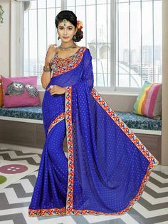 Buy latest sarees collection of designer wedding sarees for womens. Grab this faux chiffon Chinon Brasso Jari work with stone Saree. A leading online sarees store offers designer sarees. Grab this stylish red trendy saree for ceremonial, festival and party.