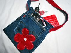 Denim Do Over | Jean and Corduroy Purse With A Beaded Floral Accent | http://www.denimdoover.com
