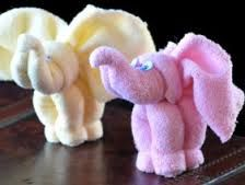 Wash Cloth Elephants Tutorial and Videos. Perfect for a Baby Shower Gift.