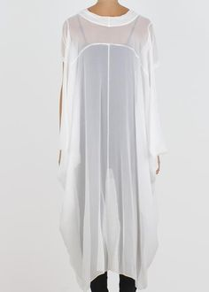 Signature billowing chiffon top with a generous, flowing cut. Short sleeves and a softly draped cowl. Made of delicate silk chiffon.