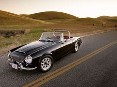 motoriginal:  The 1967 Datsun 2000 Roadster was applauded as one of the most affordable sports cars of its time. It had a 2.0L engine with a 5-speed gearbox which was rare for a car of that time.  Although the car would red line doing 140mph in 4th gear, it probably had a top speed of about 120mph. It was replaced by the Z in 1969.