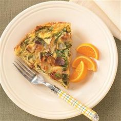 Spinach & Bacon Hash Brown Quiche Recipe -With a crust of crispy hash browns and a rich, creamy filling studded with spinach and bacon, this cheesy quiche is comfort food at its most satisfying. Delicious for breakfast, lunch or supper! Sonya Labbe - Santa Monica, California