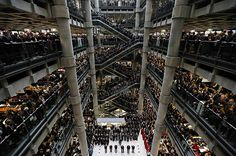 Brokers and underwriters line the balconies and escalators of the Lloyd& of London building during a service of Remembrance on November in London, England. The annual Armistice Day service honors those who have lost their lives during times of war.