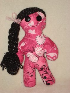 We also have Breast Cancer themed dolls, all funds from the sale of these dolls go to Breast Cancer research, only $15.00