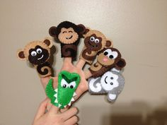 This finger puppet set includes 6 puppets: Crocodile 5 Monkeys (4 brown & 1 grey, unless otherwise specified)  Great for interactive play and song with children and toddlers; awesome for daycares, preschools, and playgroups, and just to have at home to sing with your kids!  Puppets are hand-cut and hand-stitched with eco-fi felt, in my smoke-free, pet-free home. They are made to order upon your request - therefore, the puppets you receive may not be exactly as shown here, but will be very...
