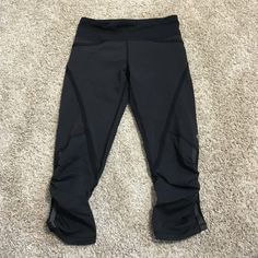 Lululemon crops Hard to find so price is firm unless you bundle!! No trades!! Great condition! Size 2, ruffle detail at calf and zipper picket on the back band lululemon athletica Pants