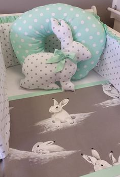 Spoil your darling angel with a Bashful Bunny themed, mint green nursery. The padded cot bumper, with a mint green frill along the top, adds that special something to the collection of the duvet, mint green polka dotted feeding pillow and the adorable handcrafted bunny plushie. This collection is apart of our Bashful Bunnies collection, and can bring smiles to anyone who enters your baby's nursery.   Check out our other ranges at: www.studiocollection.co.za