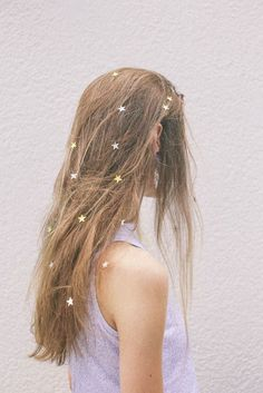 Add sparkly stars to your hair with hairspray.