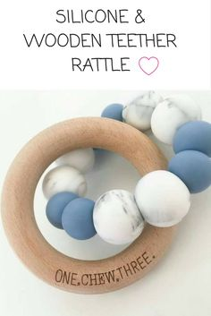 SILICONE & WOODEN TEETHER RATTLE - These little guys aren't just cute, they're practical too! #teethers #babyteeth #babygifts #parenting