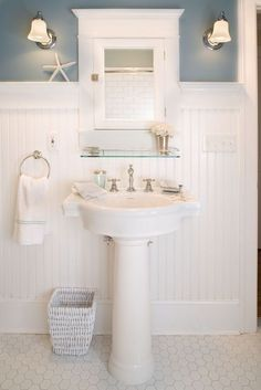 Traditional Powder Room with Wall sconce, 8 Linear ft. MDF Overlapping Wainscot Interior Paneling Kit, penny tile floors