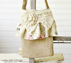 """Burlap Cross Body Tote  -  Lined the same linen cotton fabric as the ruffle, embellished w/tattered rose and ruffle ~ Lace & ruffle go all the way around the bag ~ Measures 8.5 x 13.5 inches, 46"""" handle ~ 38.00 + Ship = $48.00  -  http://www.katiesrosecottagedesigns.com/item_1687/Burlap-Cross-Body-Tote.htm  (04.25.13)"""