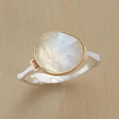 Emily Amey pairs an irregularly shaped moonstone, each unique, with a sterling silver band. 14kt gold bezel and granulations. Exclusive, handmade in...