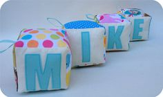 Personalized soft fabric blocks with handcut applique letters.