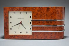 Gilbert Rohde Art Deco clock, from series introduced at the Chicago World's Fair for Herman Miller. Model 4082-B, highly figured Maidou burl veneer.