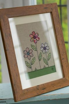 Handmade framed linen fabricpicture of flowers decorated with applique and freehand machine embroidery.  Designed and handmade by Tracey St...
