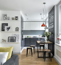 Small scandinavian kitchen with raised panel gray cabinets and light hardwood floors