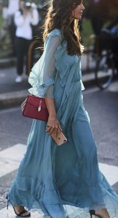 blue ruffle maxi dress. burgundy bag. #streetstyle