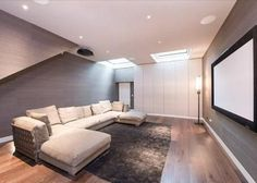 grey walls, a huge screen and comfy sofa's for the home cinema!