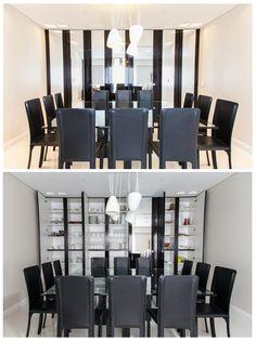 Comedor con mueble de frentes espejados. Este mueble disimula un gran vajillero y la entrada a la cocina.