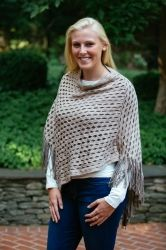 Find this sweater here!  http://www.lizabyrd.com/product/1685/Ladies/Jackets+and+Sweaters/The+Addison+Poncho+in+Camel
