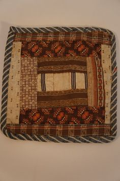 Early brown calico hand sewn pot holder; Country and Shaker Antiques